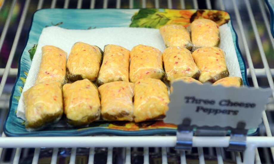 Pictured are some of the three cheese poppers available at Daviss Donuts and Deli in Nederland on Tuesday morning. The bakery is the CAT5 Restaurant of the Week for January 30, 2014. Photo taken Tuesday, 1/21/14 Jake Daniels/@JakeD_in_SETX