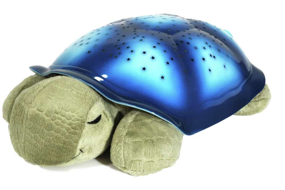 The Twilight Turtle pillow lights up the ceiling, and parents can download lullabies to the turtle via Bluetooth. Photo: Cloud B / Cloud b