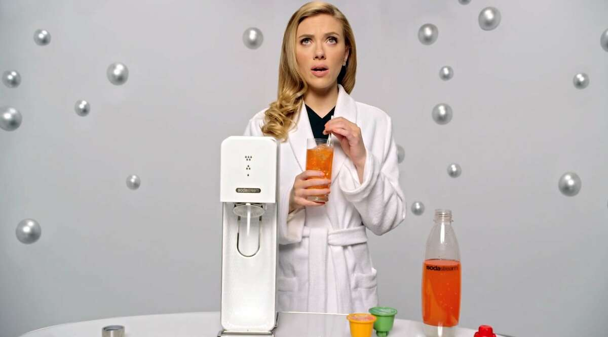 This undated frame grab provided by SodaStream, shows the company's 2014 Super Bowl commercial. SodaStream's ad features actress Scarlett Johansson promoting its at-home soda maker and will run in the fourth quarter.