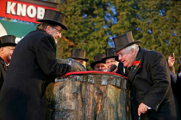 Punxsutawney Phil is held by Ron Ploucha, left, as he gives his weather prediction to Ground Hog Club President Bill Deeley, right, after emerging from his burrow on Gobblers Knob in Punxsutawney, Pa., Sunday, Feb. 2, 2014. Phil saw his shadow and forecast six more weeks of winter weather. (AP Photo/Gene J. Puskar) ORG XMIT: PAGP109 Photo: Gene J. Puskar, AP / AP