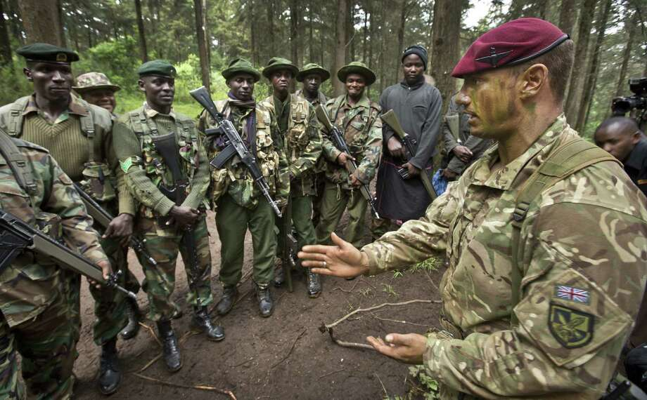 A British military officer instructs Kenyan wildlife and forest rangers as they prepare to demonstrate their new anti-poaching skills in the forest near Nanyuki, Kenya. Photo: Associated Press File Photo / AP