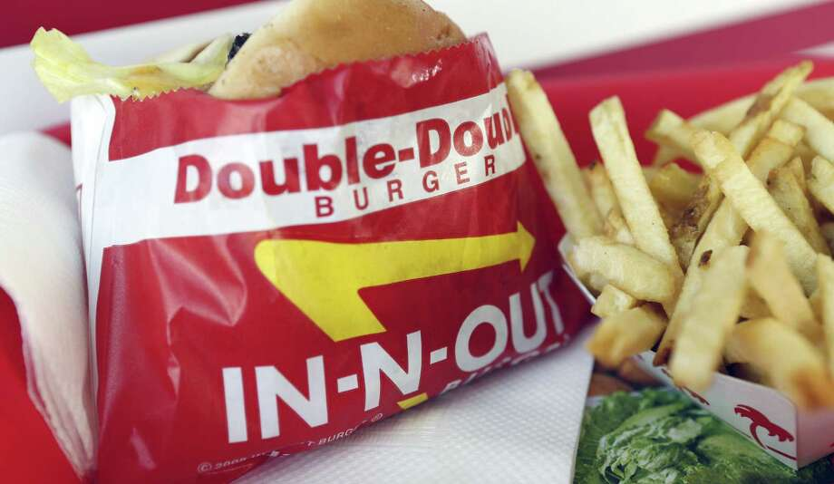 A Double-Double burger and french fries are popular offerings at In-N-Out Burger, which is planning its first area restaurant in Windcrest. No opening date has been set for the restaurant, which is proposed along with a hotel and another eatery at the site of a former Frost Bank building. Photo: Bloomberg / © 2013 Bloomberg Finance LP
