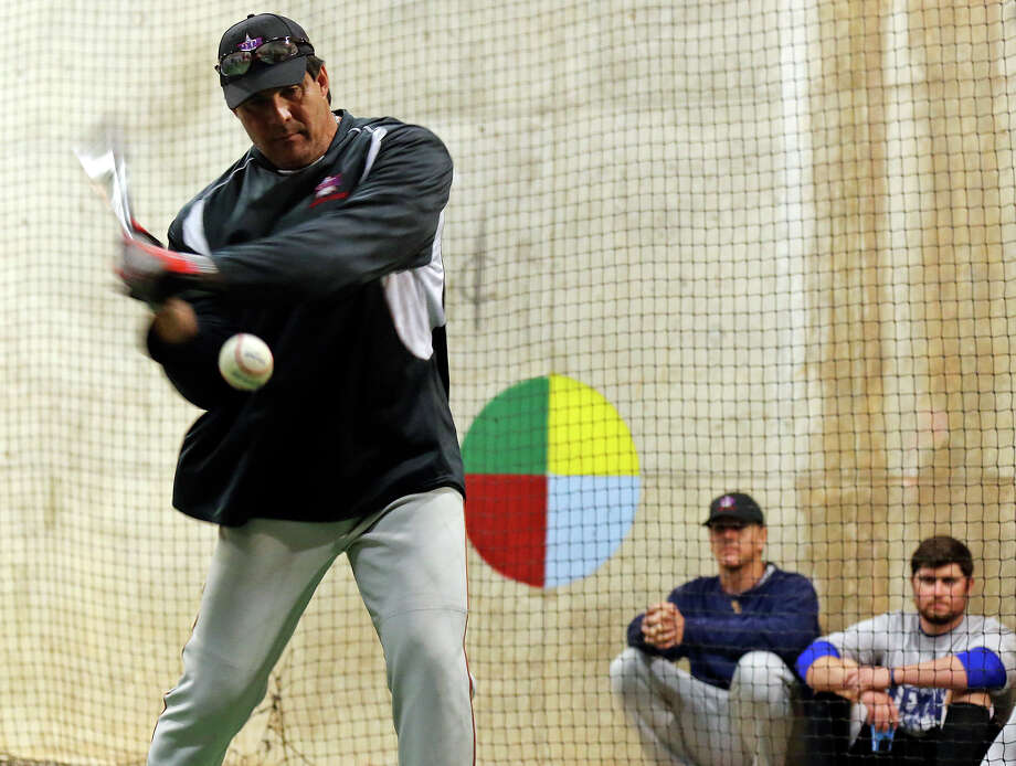Texas Winter League coach Jose Canseco demonstrates a hit during practice Sunday Feb. 2, 2014 at Nelson Wolff Stadium. Photo: Edward A. Ornelas, San Antonio Express-News / © 2014 San Antonio Express-News