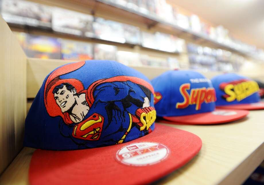 Superman baseball caps sit on a shelf at Lyons Den on Tuesday afternoon. Lyons Den in Vidor is the CAT5 FreshBiz for Jan. 30, 2014. The shop caters to comic fans and gamers alike, and hosts tournaments and participates in Free Comic Book Day. Photo taken Tuesday, 1/21/14 Jake Daniels/@JakeD_in_SETX