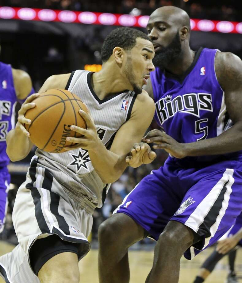 San Antonio Spurs' Cory Joseph looks for room around Sacramento Kings' Quincy Acy during second half action Saturday Feb. 1, 2014 at the AT&T Center. The Spurs won 95-93. Photo: Edward A. Ornelas, San Antonio Express-News