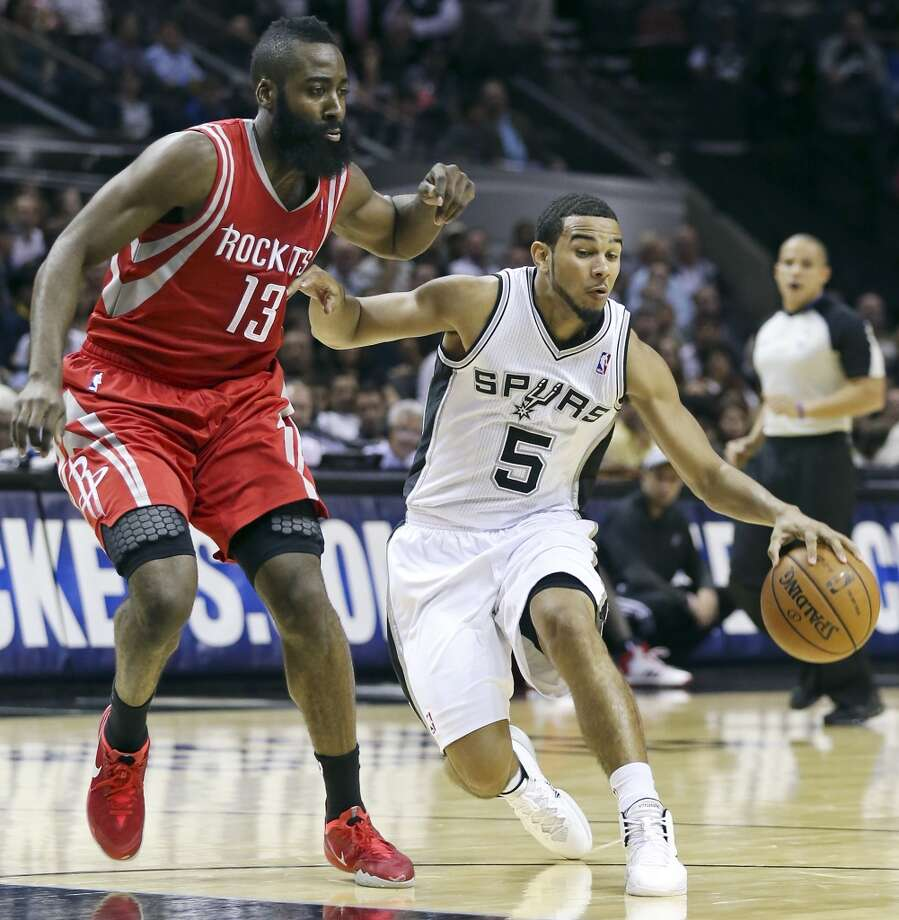 San Antonio Spurs' Cory Joseph looks for room around Houston Rockets' James Harden during first half action of a preseason game Thursday Oct. 24, 2013 at the AT&T Center. Photo: Edward A. Ornelas, San Antonio Express-News