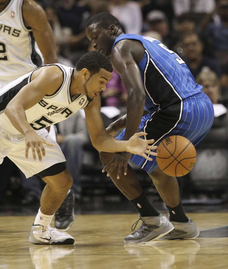 Spurs' CoryJoseph steals the ball against the Orlando Magic's Victor Oladipo during their pre-season game at the AT&T Center on Tuesday, Oct. 22, 2013. Photo: Kin Man Hui, San Antonio Express-News