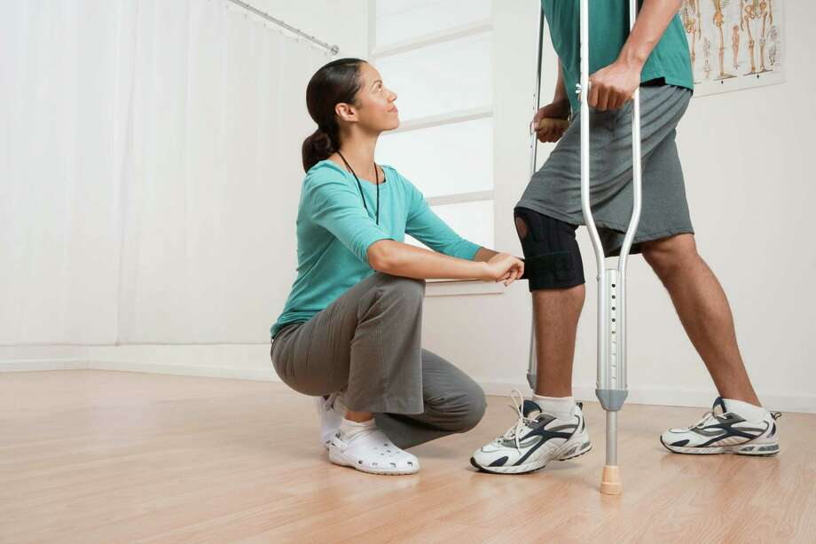 One of the top 10 occupations in highest demand is physical therapist, with a median salary of $76,310. / Creatas RF