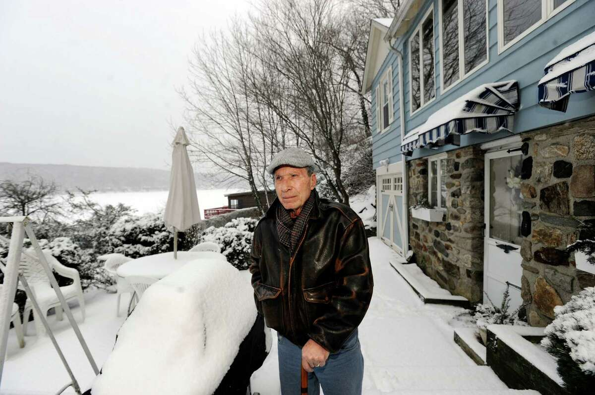 Some Danbury homeowners, particularly those living by Candlewood Lake, are upset over a large spike in their taxes. Michael Calandrino, 68, who lives with his wife Joanne, 70, on Lake Road in Danbury, Conn., is one of those complaining, Monday, Feb. 3, 2014.