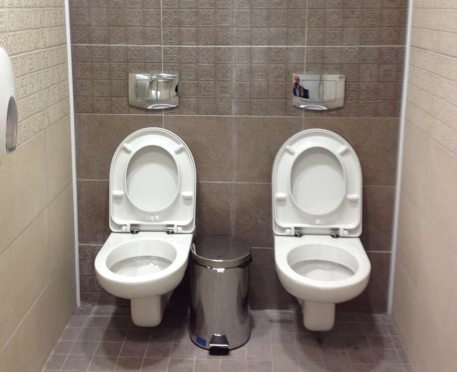 Two toilets at the cross-country skiing and biathlon center for the Olympics in Sochi, Russia. Strange? See other bizarre toilets around the globe. (AP Photo/Steve Rosenberg, BBC) Photo: Steve Rosenberg, Associated Press