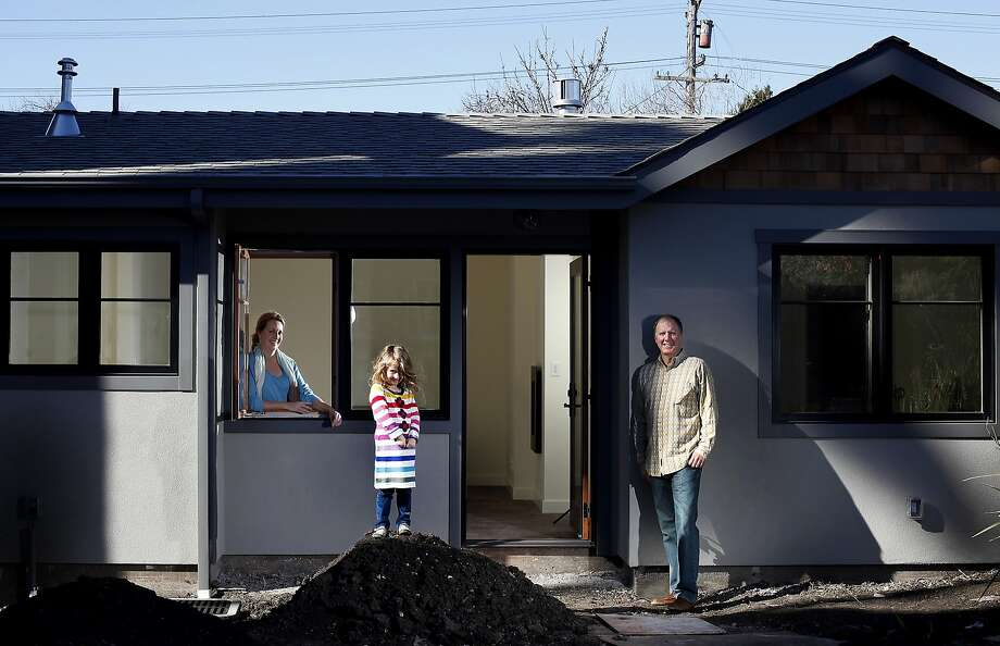 Nancy and Bruce Chamberlain, with 5-year-old daughter Lillie, are excited about the new 640-square-foot cottage in their yard, which still needs some final touches. Photo: Sarah Rice, Special To The Chronicle