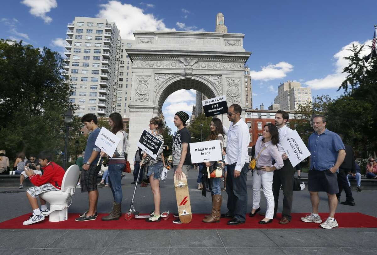 New Yorkers assembled last year to call on world leaders to increase access to sanitation and safe drinking water. Lack of water and sanitation kills more than 700,000 children each year and costs developing countries $260 billion. (Ed Rieker/AP Images for WaterAid)