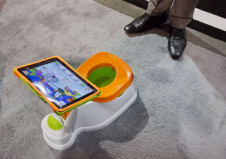 The iPotty for iPad potty training device is see on display at the Consumer Electronics Show, Wednesday, Jan. 9, 2013, in Las Vegas. No app is available to go with the trainer, but the idea is to keep the child on the toilet for as long as necessary by keeping them digitally entertained. (AP Photo/Julie Jacobson) Photo: Julie Jacobson, Associated Press