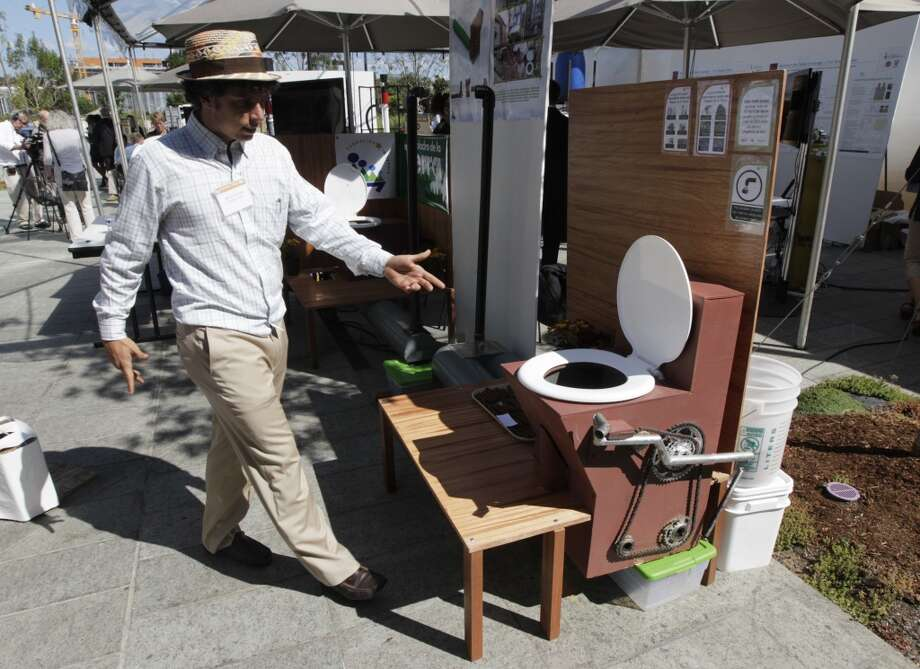 "Marcos Fiovavanti, of the Ecuador-based ""Fundacion In Terris"" group, talks about the ""Earth Auger Toliet,"" which is operated by a mechanical pedal and chain system, on display at the ""Reinventing the Toliet"" Fair, Tuesday, Aug. 14, 2012, in Seattle, which is part of a Bill & Melinda Gates Foundation competition to reinvent the toilet for the 2.6 billion people around the world who don't have access to modern sanitation. (AP Photo/Ted S. Warren) Photo: Ted S. Warren, Associated Press"