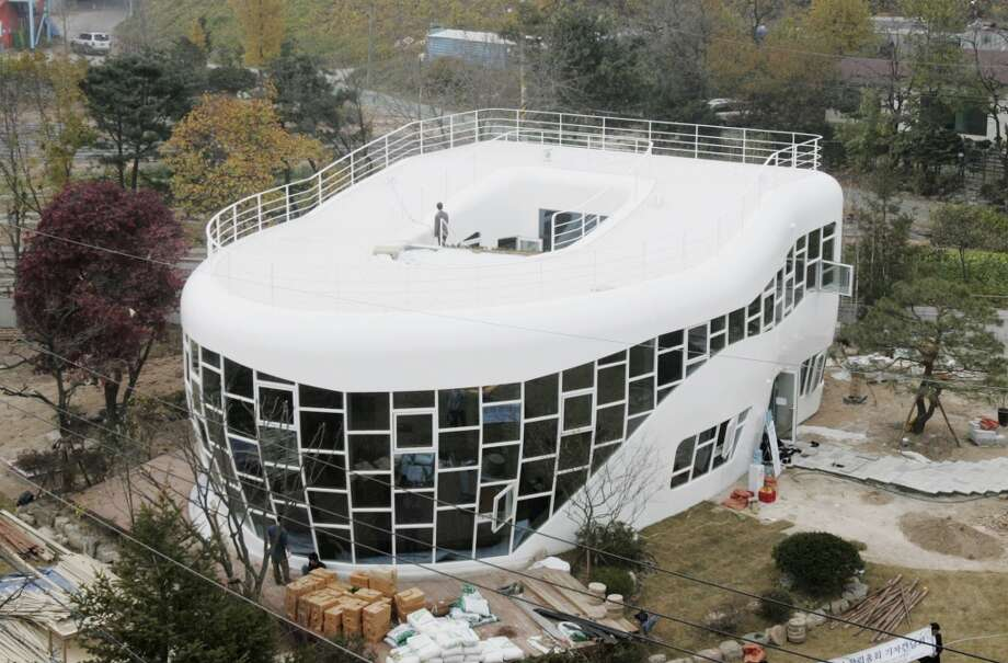 Haewoojae, the world's one and only toilet house, is seen in Suwon, south of Seoul, South Korea, Friday, Nov. 9, 2007. The  two-story house set to be finished Sunday, Nov. 11, 2007, is being built to commemorate the inaugural meeting later this month of the World Toilet Association. (AP Photo/Ahn Young-joon) Photo: Ahn Young-joon, AP