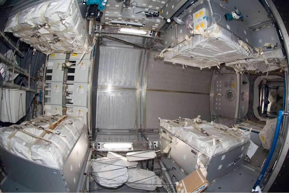 This image provided by NASA shows an interior view of the Leonardo Multi-Purpose Logistics Module attached to the Earth-facing port of the International Space Station's Harmony node. Leonardo was moved from Space Shuttle Endeavour's cargo bay and linked to the station on Monday Nov. 17, 2008 carrying two water recovery systems racks for recycling urine into potable water, a second toilet system, new gallery components, two new food warmers, a food refrigerator, an experiment freezer, combustion science experiment rack, two separate sleeping quarters and a resistance exercise device that allows station crewmembers to perform a variety of exercises.. (AP Photo/NASA) Photo: AP