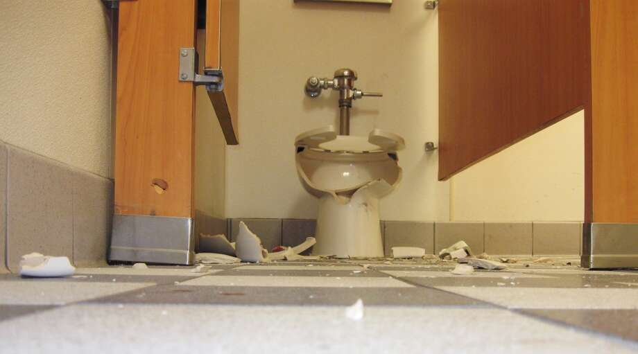 In this Tuesday, Jan. 13, 2009 file photo released by the Centerville Police Dept.shows a shattered toilet in the restroom a Carl's Jr. restaurant  in Centerville, Utah A toilet that was the victim of an accidental gunshot was remembered fondly during a memorial ceremony. (AP Photo/Centerville Police Dept., file) Photo: HO, AP