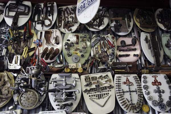 Barney Smith's creativity and imagination has led to create over 700 different types of artwork from toilet seats as seen July 7, 2006, in San Antonio. His work reflects his own style, events in history or just whimsy. (AP Photo/San Antonio Express-News, Kin Man Hui) ** MAGS OUT NO SALES **