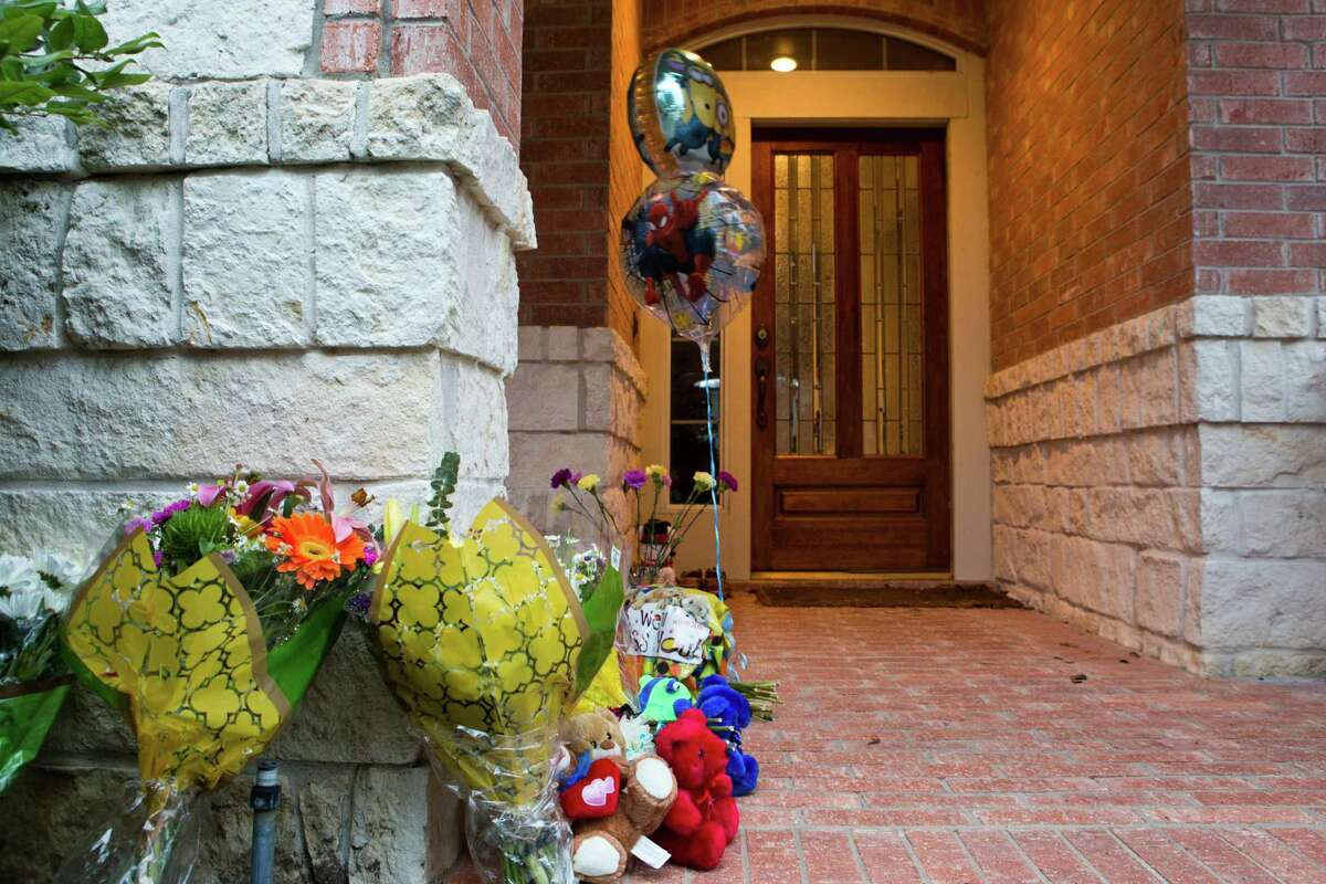 A memorial with cards, flowers and balloons has been placed on the home of the family in Cypress that was found deceased by the authorities on Thursday. The home is located at 14015 Fosters Creeks Drive in Cypress. Monday, Feb. 3, 2014.