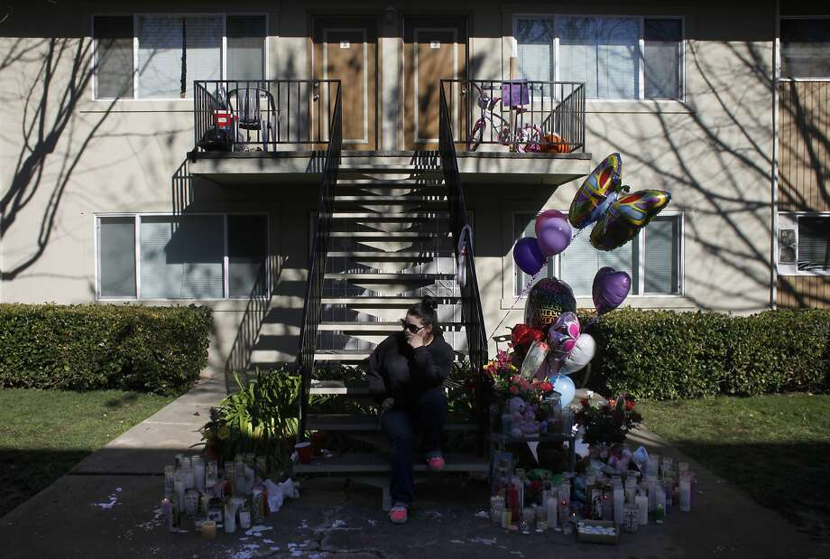 Savannah Fanjul thinks about her step-sister Kayleigh Slusher, Monday February 3, 2014, as she sits on the steps at the memorial outside the apartment building in Napa, Calif.  Three year old Kayleigh Slusher was found dead, Saturday in her bed. The mother Sara Krueger and her boyfriend Ryan Scott Warner have been arrested on suspicion of  murder and assault in connection with the killing of Kayleigh. Photo: Lacy Atkins, The Chronicle