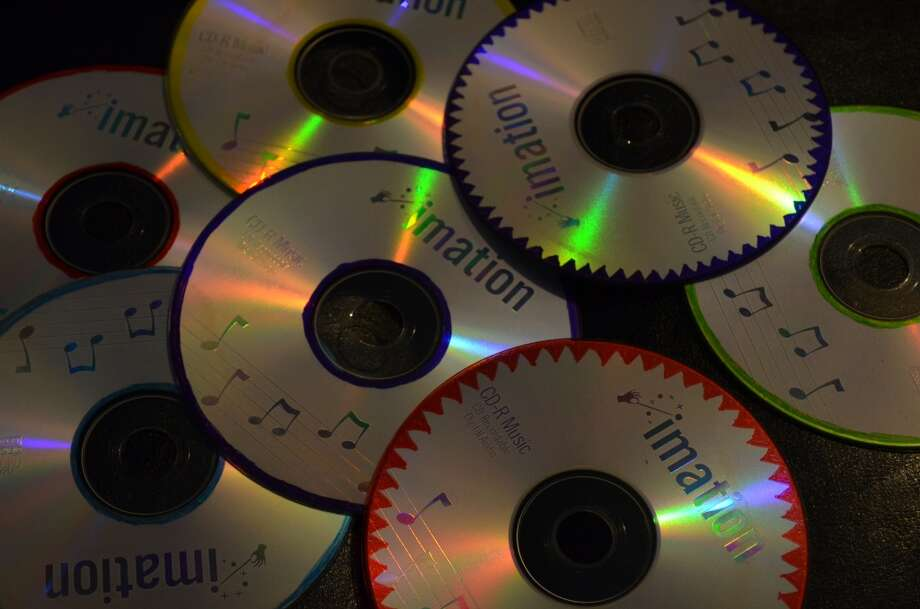 Burning CDs -we were all little DJs in our own right. Photo: Ashley Bellinger