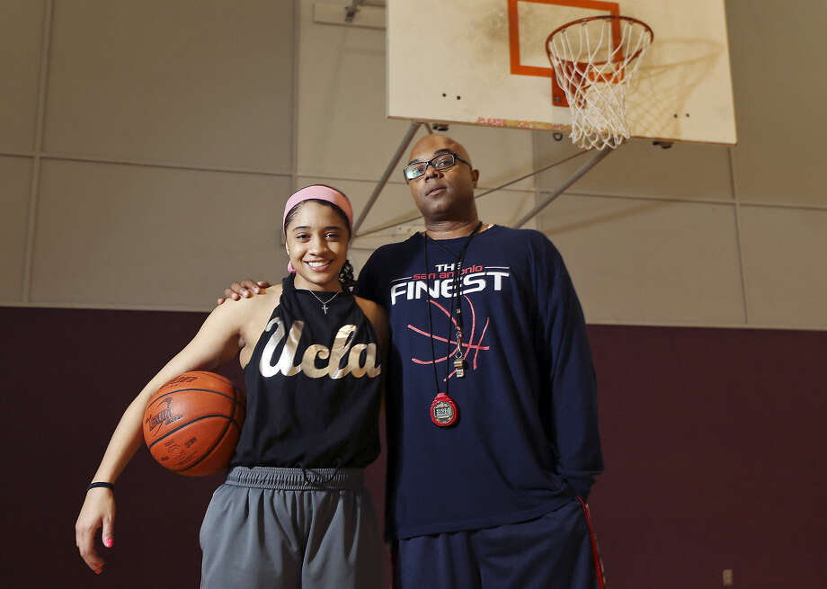 Point guard Receé Caldwell, seen here with her father and coach Ray Caldwell, averaged 18.3 points a game. Photo: File / San Antonio Express-News / © 2013 San Antonio Express-News