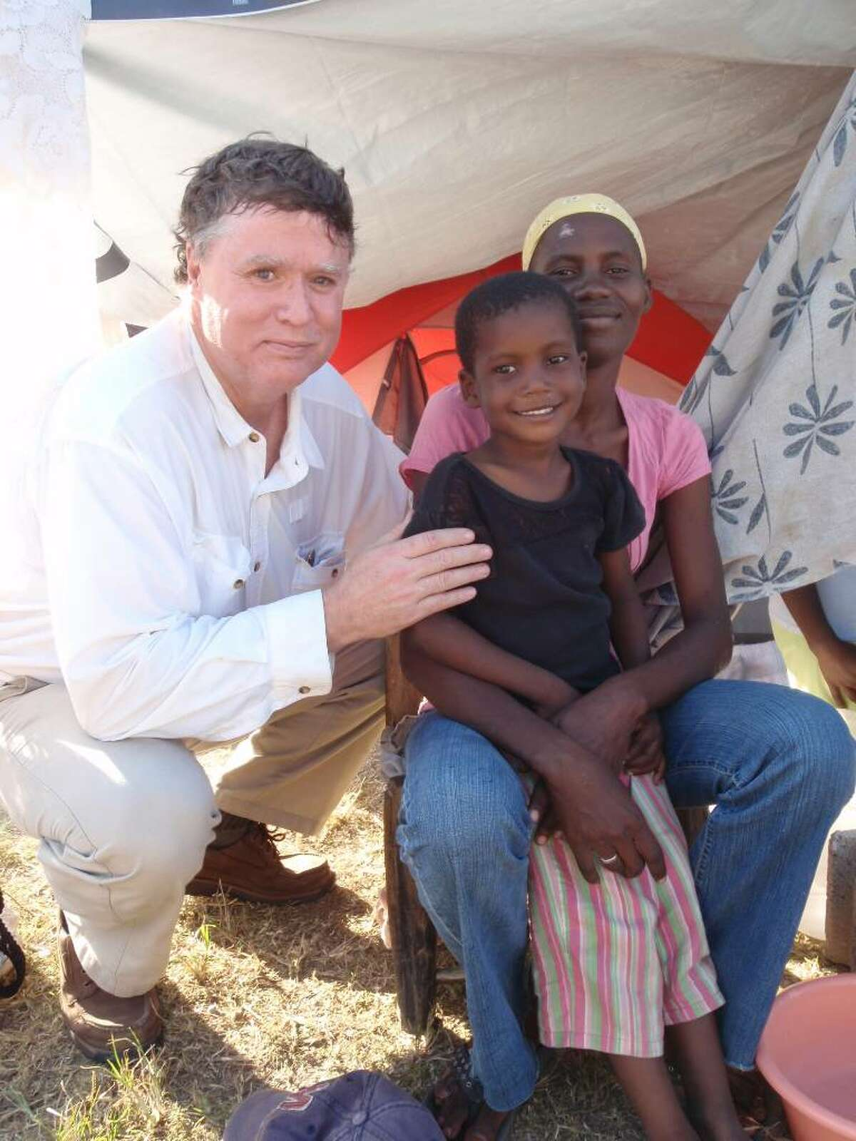 Dr. David Reed poses with victims of the Haitian earthquake, Jan. 2010.