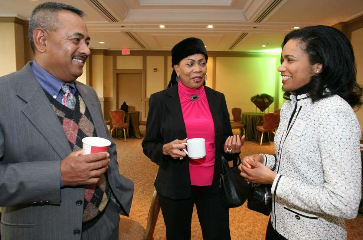 2010 Brava Award winner Donna-Marie Nanasseh, MD speaks with her parents Reginald and Cherry before the start of Friday's award ceremony at the Hyatt Regency Greenwich.