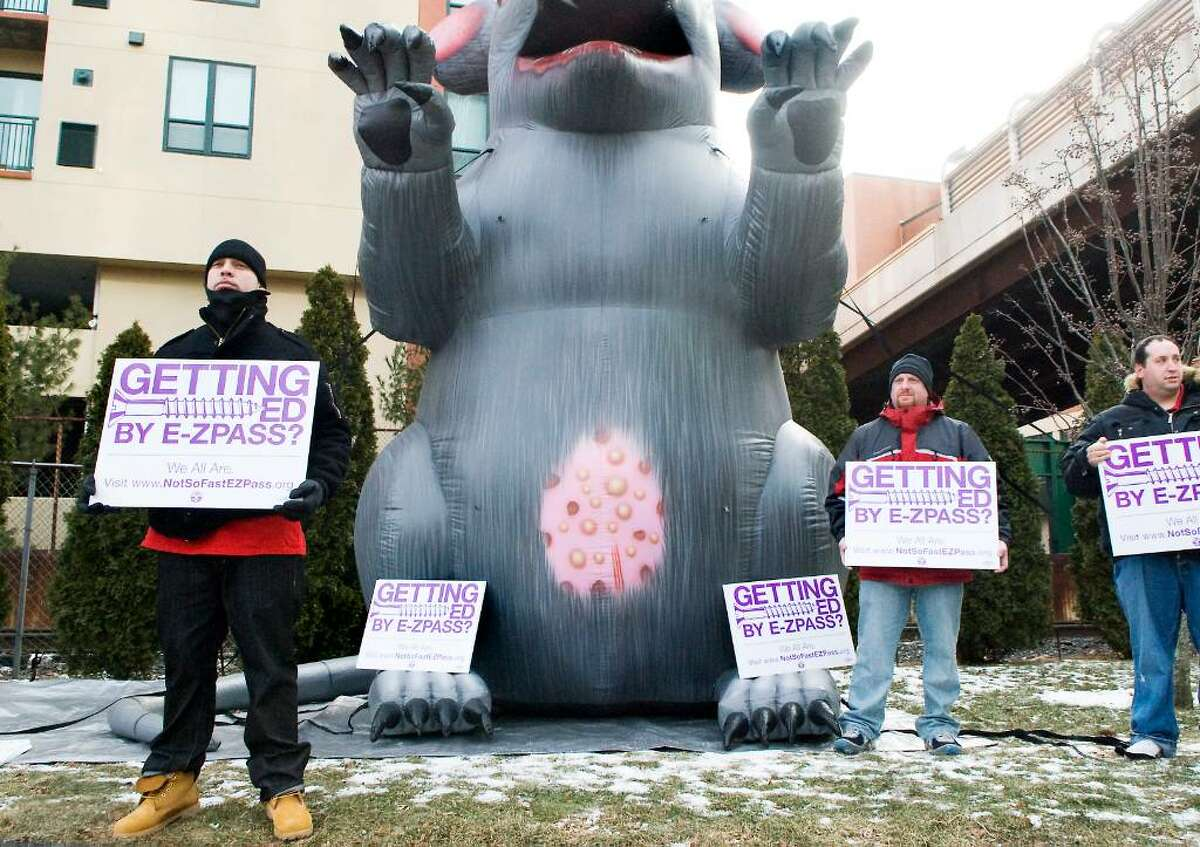 Isaac Colinares, John Castella and Joe Tarulli join other employees from E-Z Pass and members of the Communications Workers of America as they picket outside Xerox while shareholders arrive to vote on the acquisition of Affiliated Computer Services in Norwalk, Conn. on Friday, Feb. 5, 2010. The group is in a labor dispute with ACS.