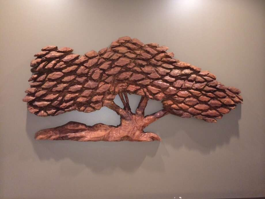 Richard Seward's oak tree carving on the back wall of the new Peet's on Chestnut Street. The Chronicle/Sam Whiting