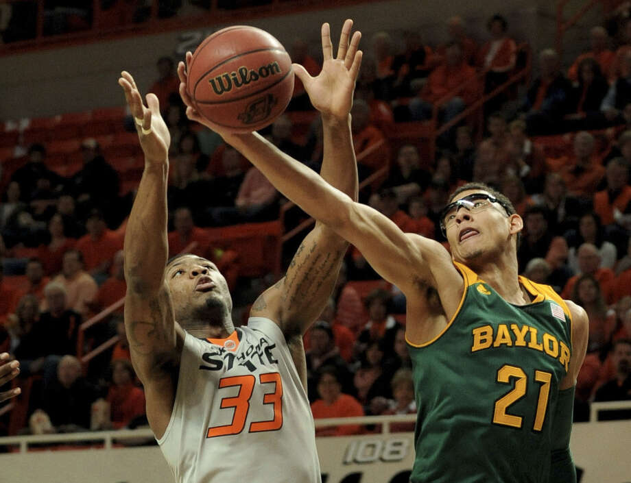 Baylor and Isaiah Austin snapped a five-game losing streak with an impressive win over Marcus Smart and Oklahoma State despite the Bears' numerous issues trying to get to Stillwater, Okla. Photo: Brody Schmidt / Associated Press / FR79308 AP