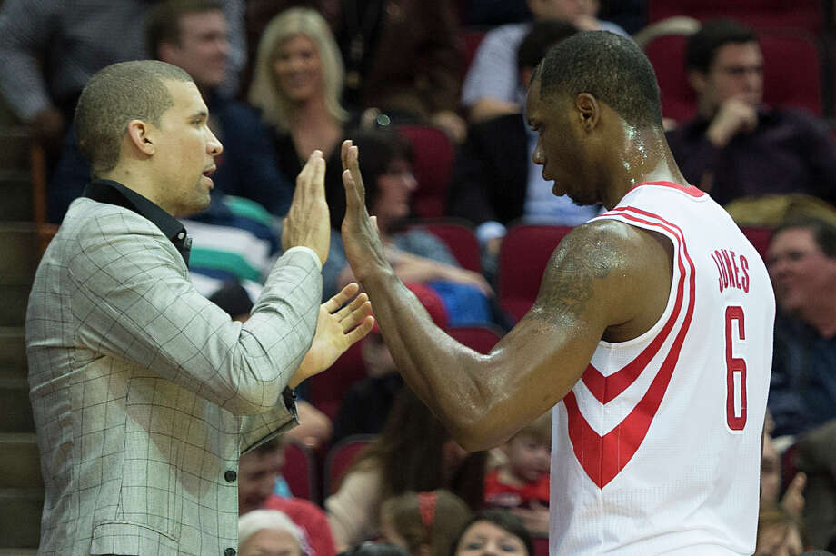 The Rockets' Francisco Garcia, left, high-fiving forward Terrence Jones, has missed eight games with a sore knee but said Monday he is ready to return. Photo: Smiley N. Pool, Staff / © 2014  Houston Chronicle