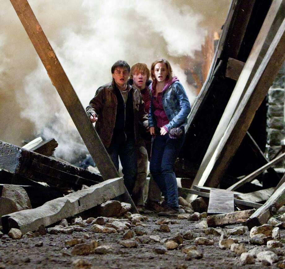Jaap Buitendijk/Warner Bros. Pictures (L-r) DANIEL RADCLIFFE as Harry Potter, RUPERT GRINT as Ron Weasley and EMMA WATSON as Hermione Granger in Warner Bros. Pictures? fantasy adventure ?HARRY POTTER AND THE DEATHLY HALLOWS ? PART 2,? a Warner Bros. Pictures release. Photo: Jaap Buitendijk / (C) 2011 WARNER BROS. ENTERTAINMENT INC. HARRY POTTER PUBLISHING