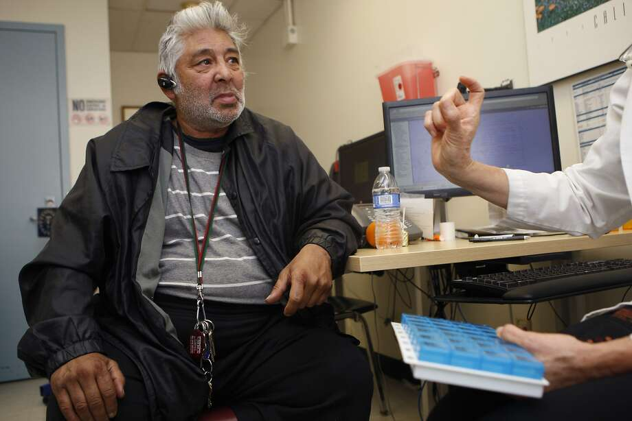 "Patient Gabriel Vicario, Jr. (left), meets with registered nurse Fern Ebeling (right) to discuss his medication at San Francisco General Hospital in San Francisco, Calif., on Friday, January 24, 2014.  SF General Hospital has a program inspired by Dr. Jeffrey Brenner focusing on ""hotspotting"" -- basically reducing costs for the most frequent utilizers of the hospital. Photo: Liz Hafalia, The Chronicle"