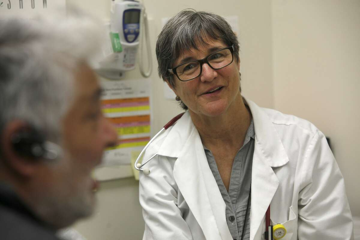 """Registered nurse Fern Ebeling (middle) meets with patient Gabriel Vicario, Jr. (left), to discuss his medication at San Francisco General Hospital in San Francisco, Calif., on Friday, January 24, 2014. SF General Hospital has a program inspired by Dr. Jeffrey Brenner focusing on """"hotspotting"""" -- basically reducing costs for the most frequent utilizers of the hospital."""