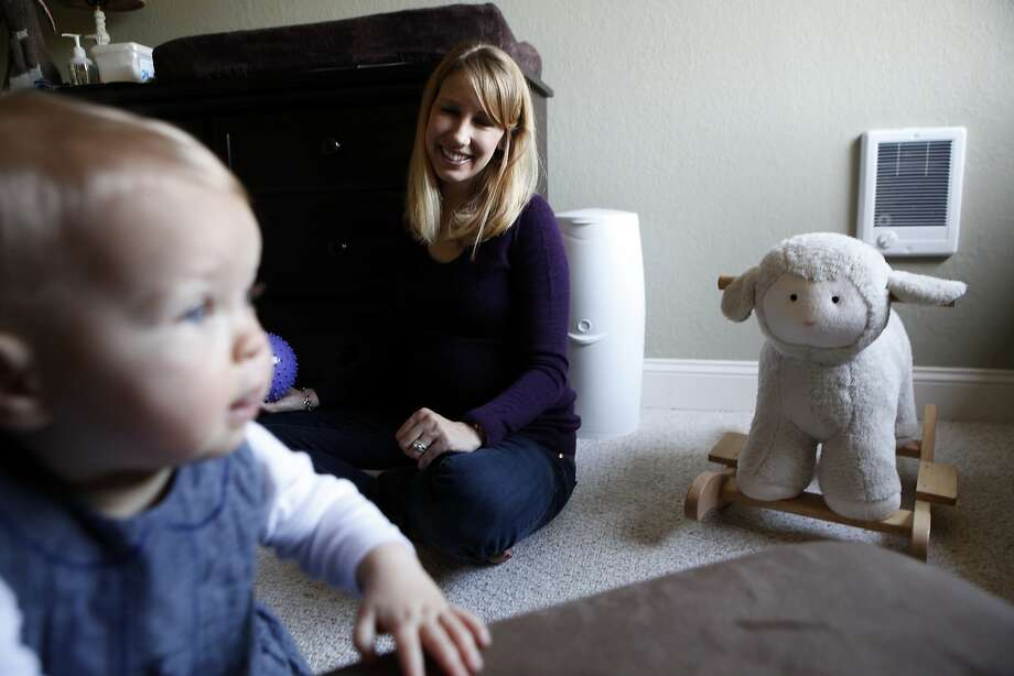 Elizabeth Barnett, who lost her first child to preeclampsia, plays with her 10-month-old daughter, Quinn, in their San Jose home. Photo: Michael Short, The Chronicle