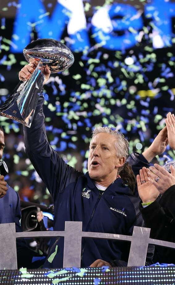 Head coach Pete Carroll hoists the Lombardi Trophy after the Super Bowl. Photo: Matthew Emmons, Reuters