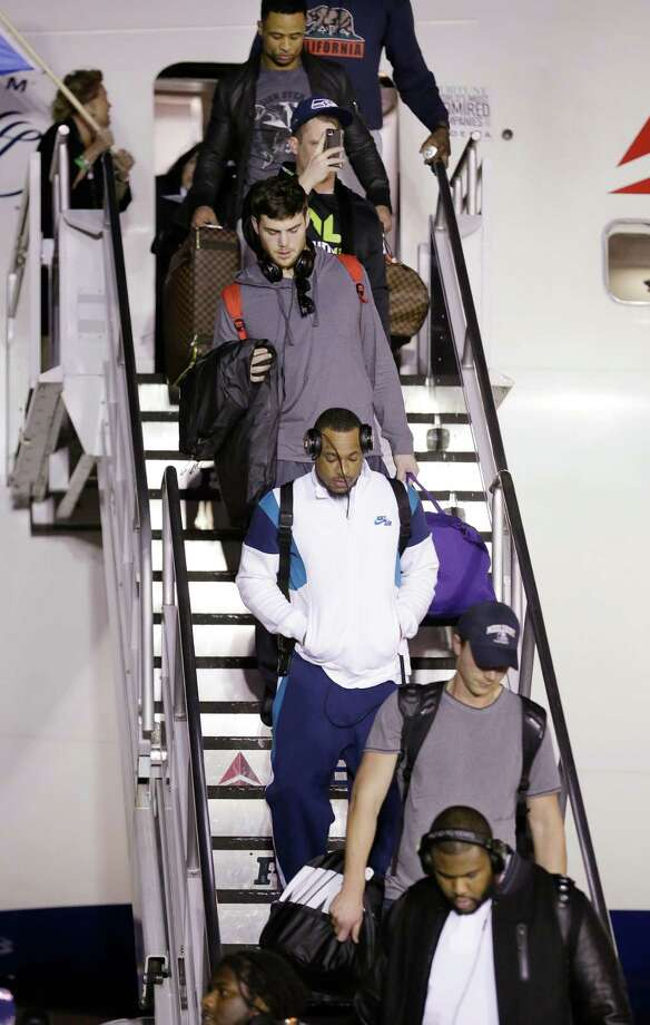 Seattle Seahawks players walk down stairs off the plane on the team's arrival Monday, Feb. 3, 2014, at Seattle-Tacoma International Airport in Seattle. The Seahawks beat the Denver Broncos 43-8 in the Super Bowl on Sunday. Photo: Elaine Thompson, AP / AP