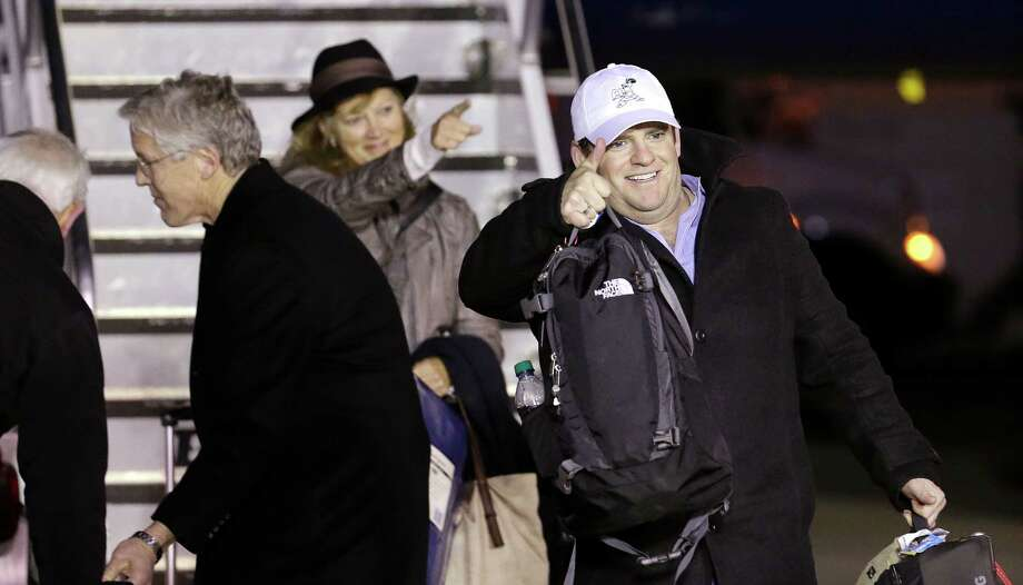 Seattle Seahawks general manager John Schneider, gives a thumbs-up to fans on the team's arrival Monday, Feb. 3, 2014, at Seattle-Tacoma International Airport in Seattle. The Seahawks beat the Denver Broncos 43-8 in the Super Bowl on Sunday. Photo: Elaine Thompson, AP / AP