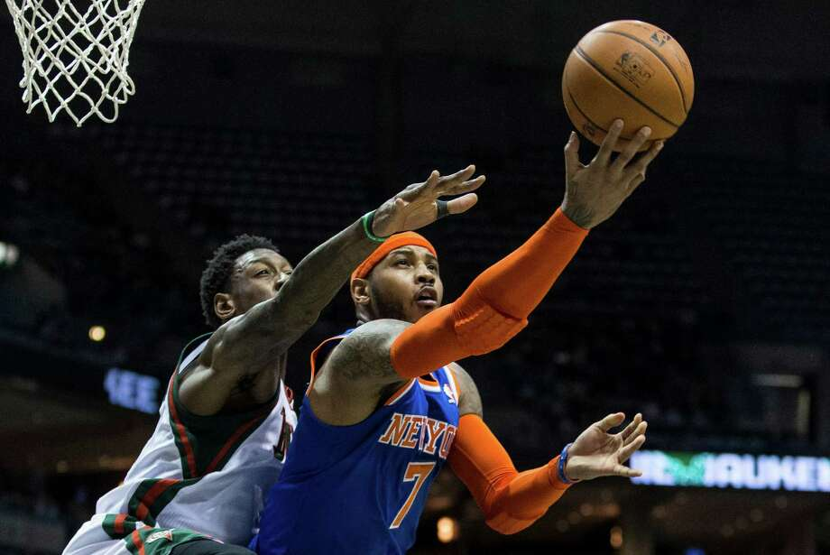 New York Knicks' Carmelo Anthony shoots the ball against Milwaukee Bucks' Larry Sanders during the first half of an NBA basketball game, Monday, Feb. 3, 2014, in Milwaukee. (AP Photo/Tom Lynn)  ORG XMIT: WITL106 Photo: Tom Lynn / FR170717 AP