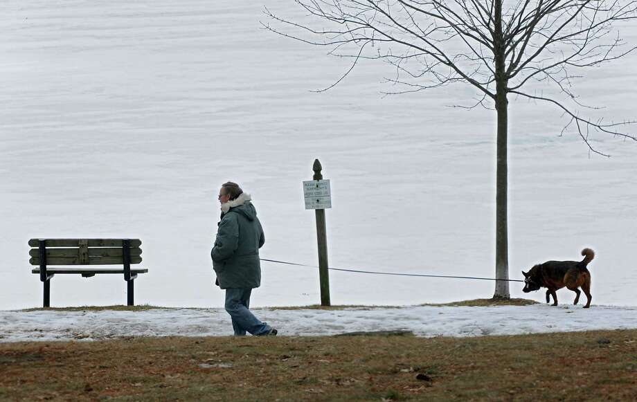 Richard Hubert of Schenectady walks his dog Jake around the lake in Central Park on Monday, Feb. 3, 2014, in Schenectady, N.Y. (Lori Van Buren / Times Union) Photo: Lori Van Buren / 00025600A