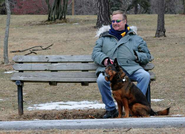 Richard Hubert of Schenectady takes a break while on a walk with his dog Jake around the lake in Central Park on Monday, Feb. 3, 2014, in Schenectady, N.Y. (Lori Van Buren / Times Union) Photo: Lori Van Buren / 00025600A