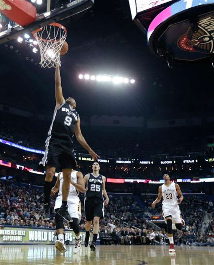 San Antonio Spurs point guard Tony Parker (9) drives to the basket in the first half of an NBA basketball game against the New Orleans Pelicans in New Orleans, Monday, Feb. 3, 2014. (AP Photo/Gerald Herbert) Photo: Gerald Herbert, AP / AP