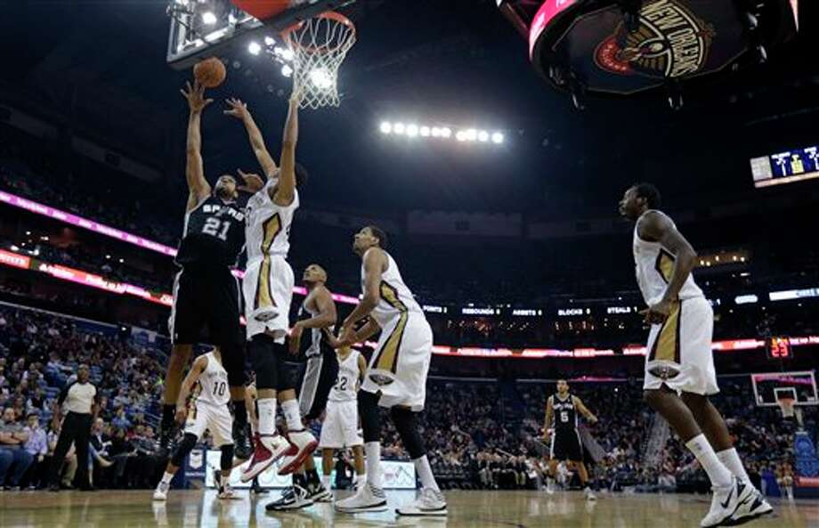 San Antonio Spurs power forward Tim Duncan (21) shoots against New Orleans Pelicans power forward Anthony Davis (23) in the first half of an NBA basketball game in New Orleans, Monday, Feb. 3, 2014. (AP Photo/Gerald Herbert) Photo: Gerald Herbert, AP / AP