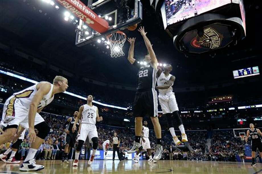 San Antonio Spurs center Tiago Splitter (22) shoots in front of New Orleans Pelicans shooting guard Anthony Morrow (3) in the first half of an NBA basketball game in New Orleans, Monday, Feb. 3, 2014. (AP Photo/Gerald Herbert) Photo: Gerald Herbert, AP / AP