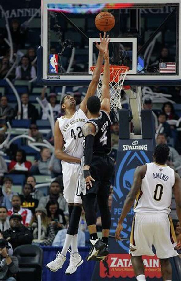 New Orleans Pelicans center Alexis Ajinca (42) tries to block a shot by San Antonio Spurs shooting guard Danny Green (4) in the first half of an NBA basketball game in New Orleans, Monday, Feb. 3, 2014. (AP Photo/Gerald Herbert) Photo: Gerald Herbert, AP / AP