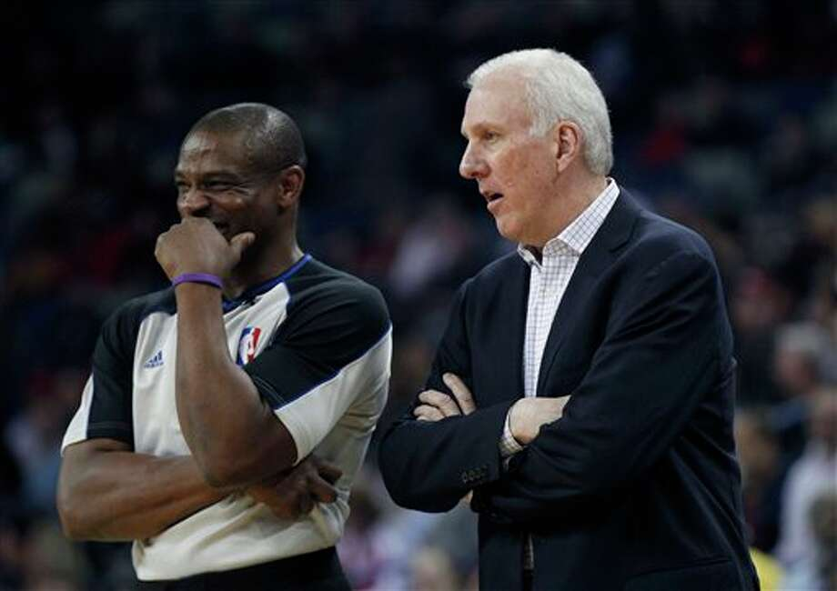 San Antonio Spurs head coach Gregg Popovich talks to an official in the first half of an NBA basketball game against the New Orleans Pelicans in New Orleans, Monday, Feb. 3, 2014. (AP Photo/Gerald Herbert) Photo: Gerald Herbert, AP / AP
