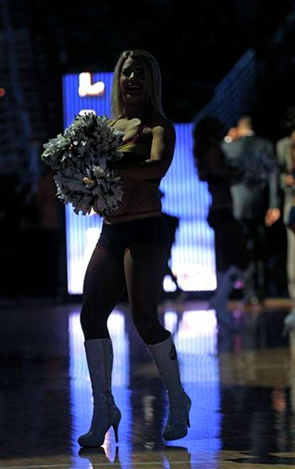 New Orleans Pelicans cheerleaders perform before an NBA basketball game against the San Antonio Spurs in New Orleans, Monday, Feb. 3, 2014. (AP Photo/Gerald Herbert) Photo: Gerald Herbert, AP / AP