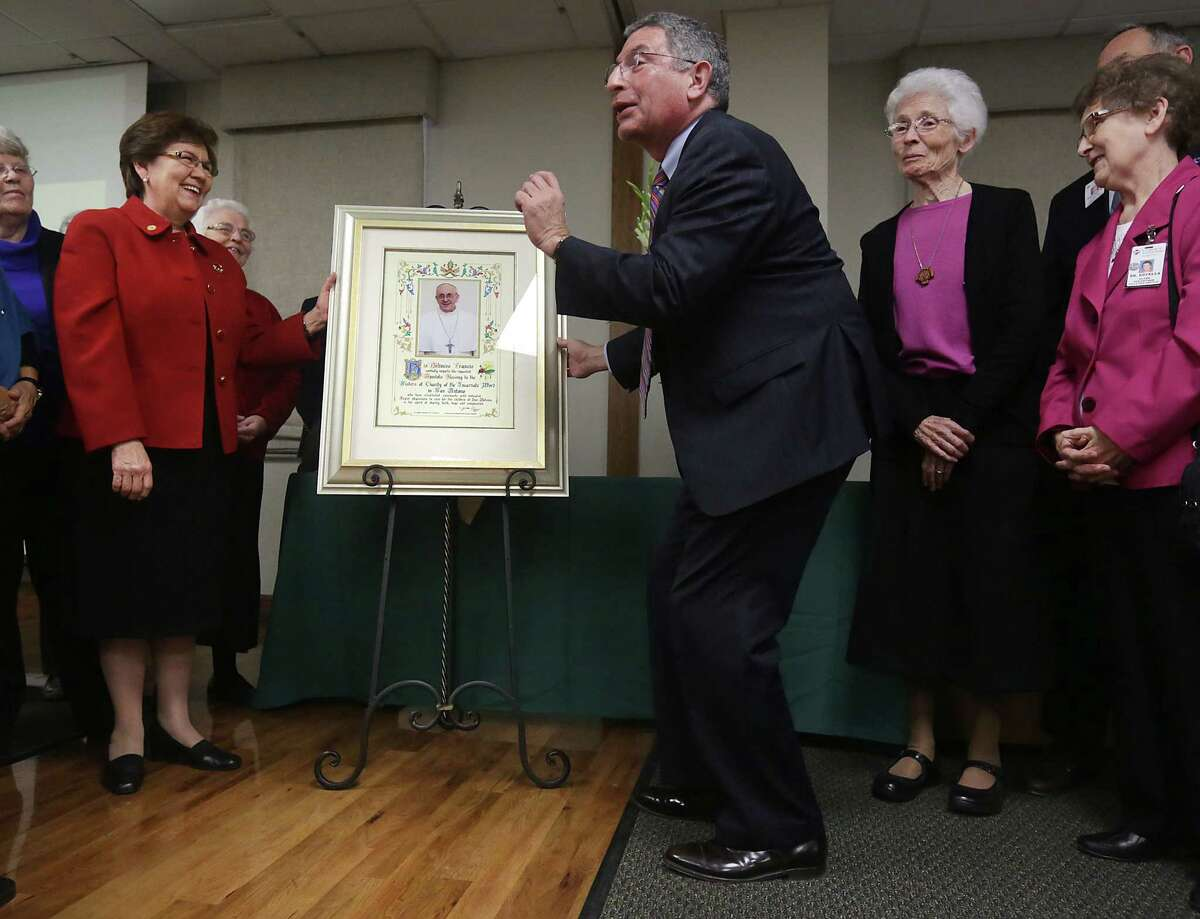Dr. Paul Klotman, president and CEO of Baylor College of Medicine, jokes that it took a Jewish man to get a papal blessing for the Children's Hospital of San Antonio. Sisters Yolanda Tarango (left) and Sara Lennon and Margaret Carew flank him.