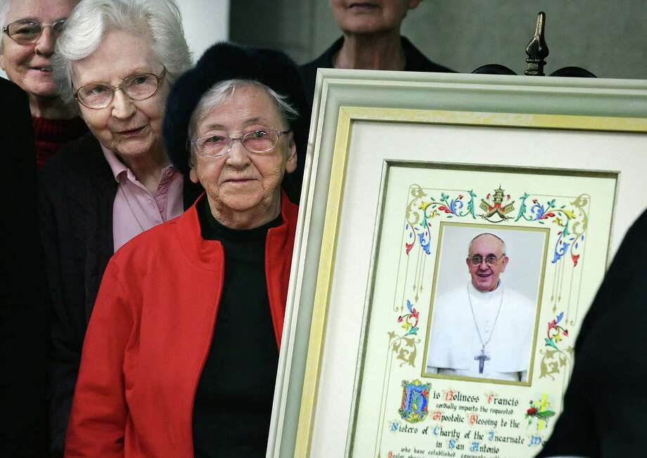 Sisters Annella Conway (from left), Grace O'Meara and Trish Freeman pose by Pope Francis' blessing, written on parchment in calligraphy, embossed with the Vatican seal and signed. Photo: Bob Owen / San Antonio Express-News / © 2012 San Antonio Express-News